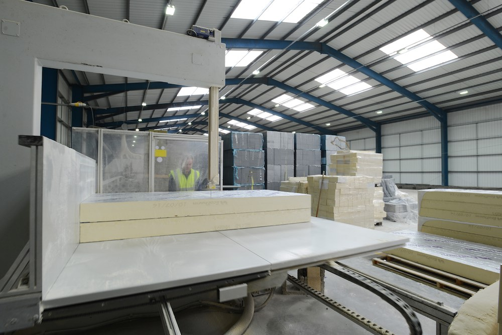 Benefits of woodcrete ICF. Photo of the manufacturing of Durisol Insulation